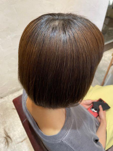 ブリーチ毛に髪質改善縮毛矯正をした髪の写真(サイドバック)